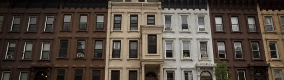 Brownstone buildings line a street in the Bedford Stuyvesant neighborhood of Brooklyn, NY, Wednesday August 13, 2014. City Shares is an investment fund that allows small investors to access the residential real estate market in Bed Stuy and other New York neighborhoods. Photograph: Victor J. Blue