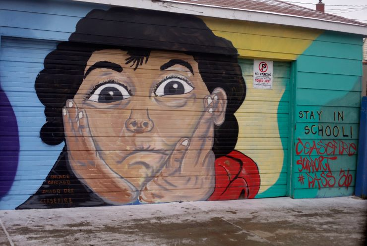 A mural in the Little Village neighborhood, one of Chicago's most violent. (Photo by Joshua Lott for The Trace)